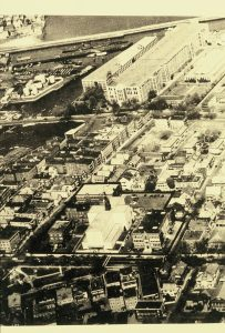 Photo of the Point, circa 1950, shows the neighborhood anchored by the Naumkeag Mill (top of photo) and the St. Joseph's Church (1948 structure, bottom of photo).