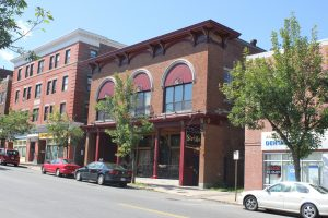A view of Lower Lafayette Street. The brick building at 94 Lafayette Street was home to many different businesses, ranging from a car dealership to a bowling alley. The Canadian Klondike Club occupied the second floor of the building until 1981.