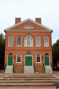 Salem's Old Town Hall was originally opened as a public marketplace. A Franco-American family operated the Subway Market in the basement of the building. The entry doors to the basement level have now been bricked over, concealing this chapter in its history.